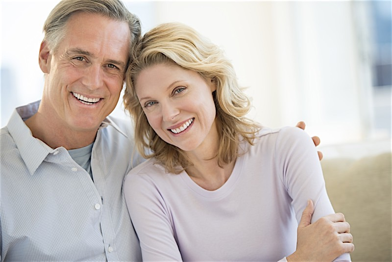 Couple Smiling with Dental Implants in Birmingham Alabama